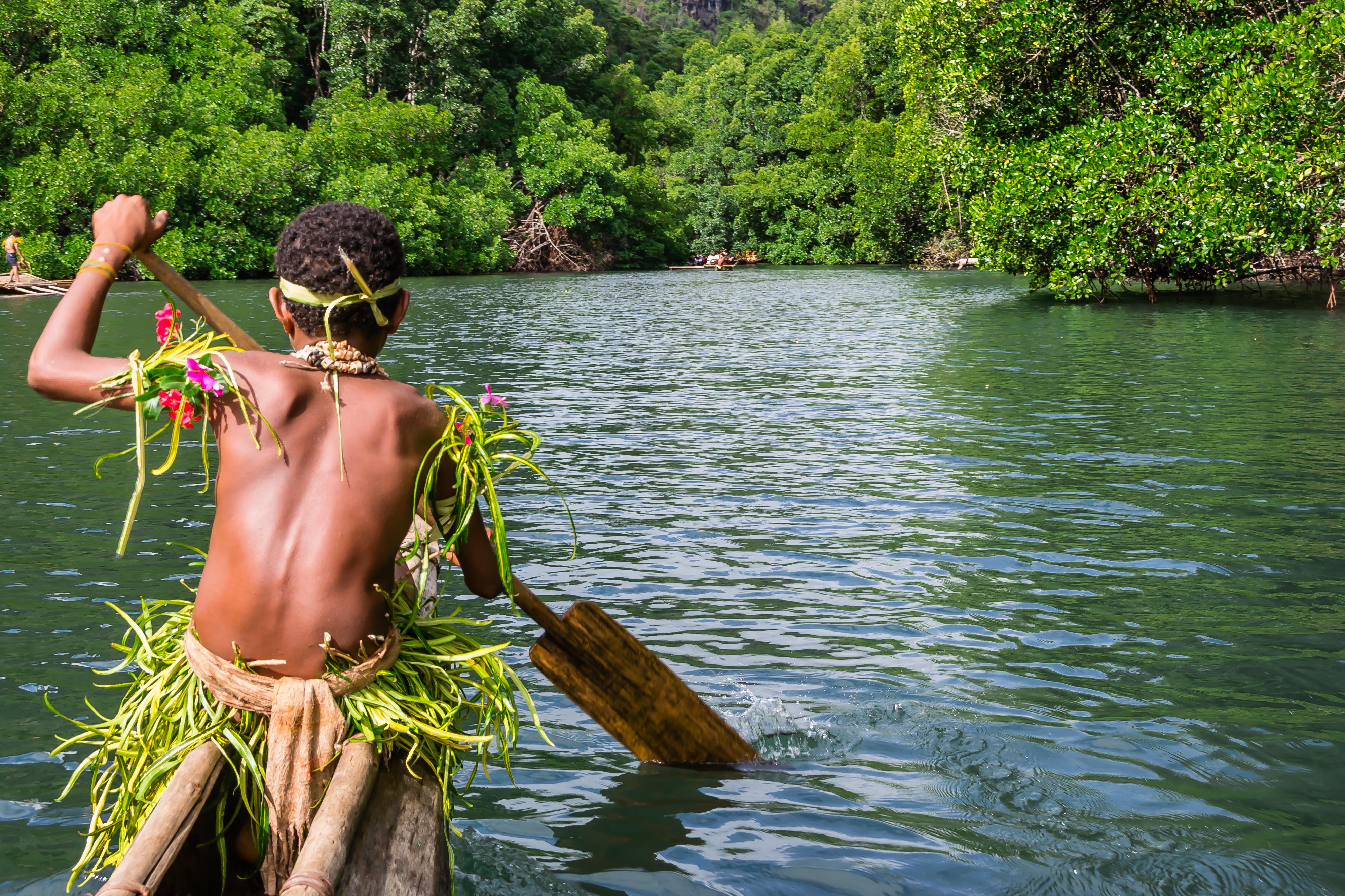 29. Canoeing in Tufi